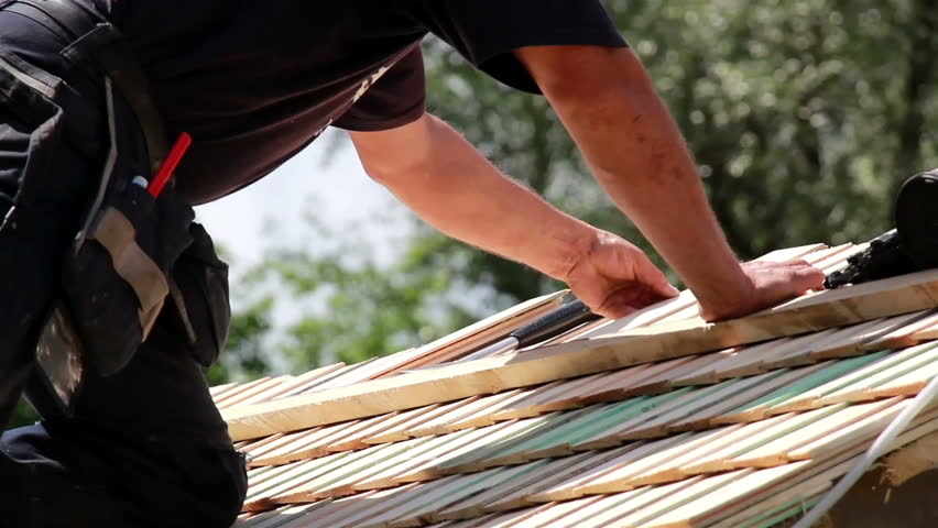 laying down roof tiles